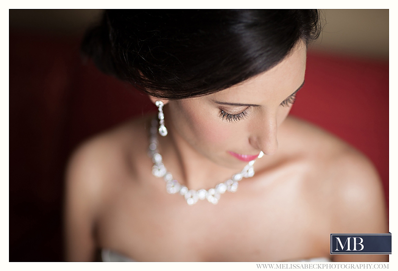bride with earings and necklace
