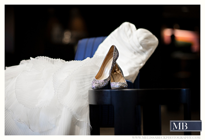 wedding dress and silver sparkle wedding shoes