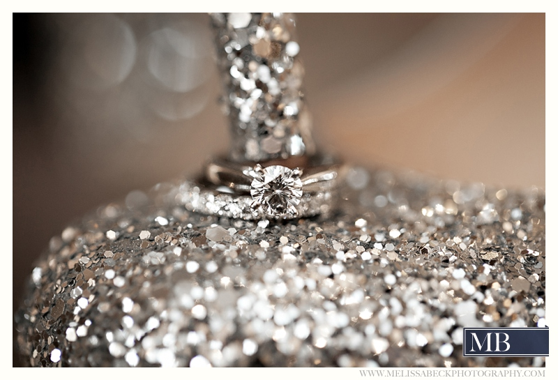 silver shoes with wedding rings