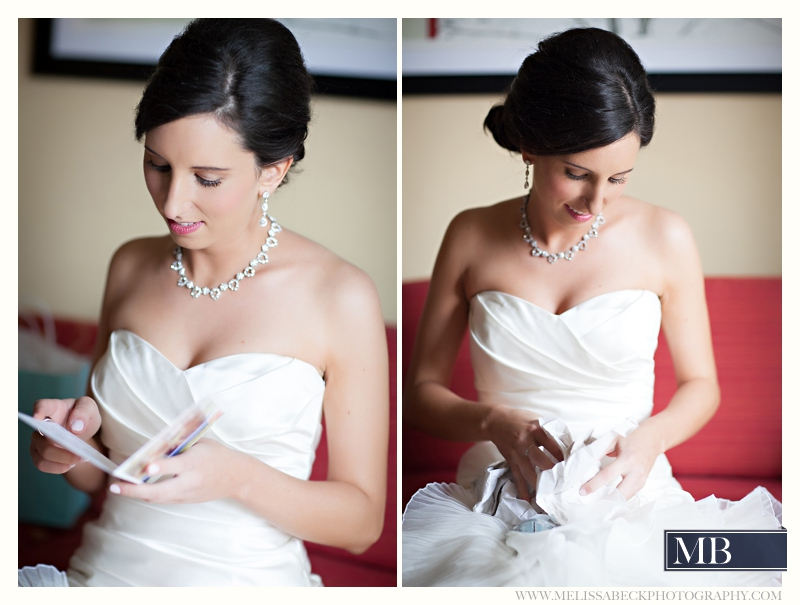 bride reading a love note on her wedding day