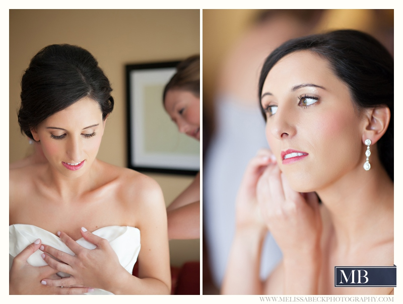 bride putting on her wedding day earings