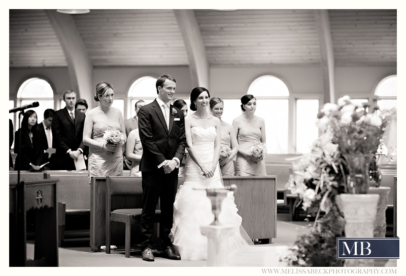 bride and groom standing at a church ceremony