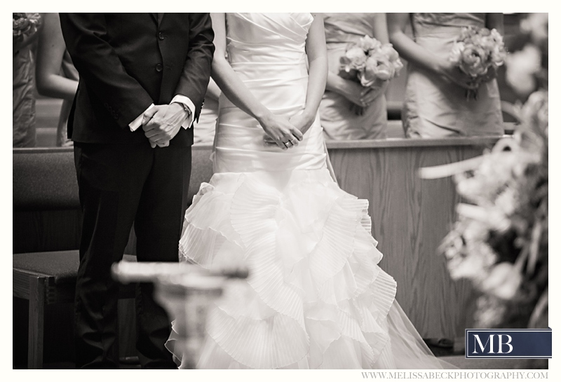 bride and groom hands folded