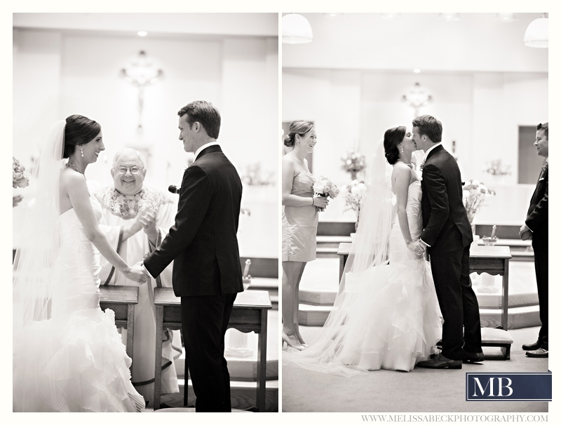 Bride and groom first kiss at a church wedding