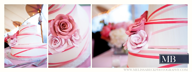 pink and white striped wedding cake with pink flowers
