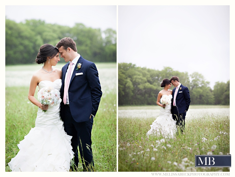 bride and groom in a field portraits