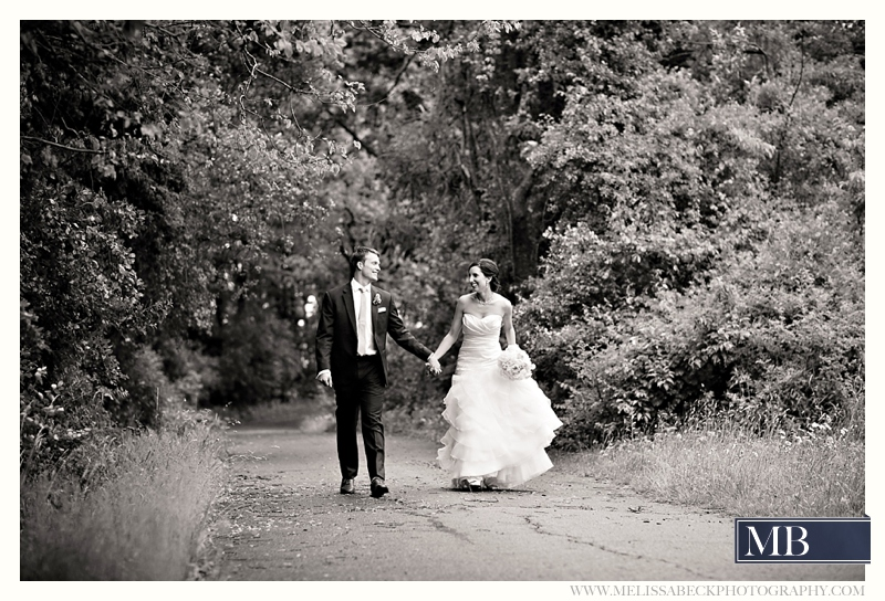 bride and groom portraits on a dirt path