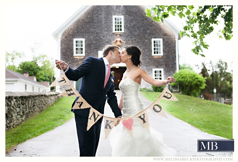 bride and groom thank you in front of gray barn at mt hope farms
