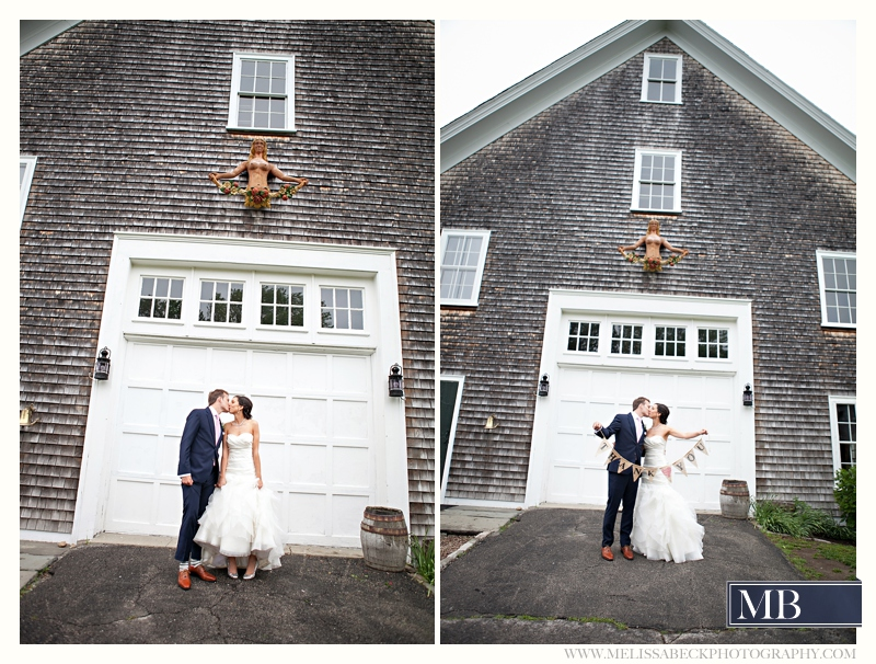bride and groom kissing in front of gray barn at mt hope farms