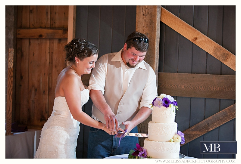 cutting the cake the barn at flanagn farm maine wedding