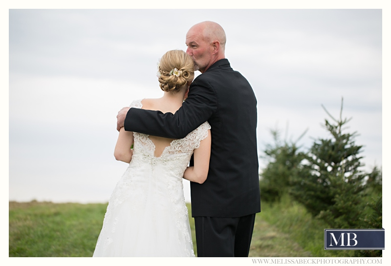 father kisses bride